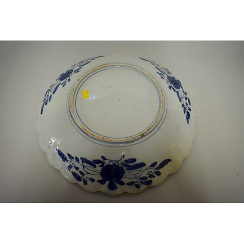 632 - <strong>A large Japanese Imari charger,</strong> <em>Meiji,</em> of shaped outline, 46cm diameter....