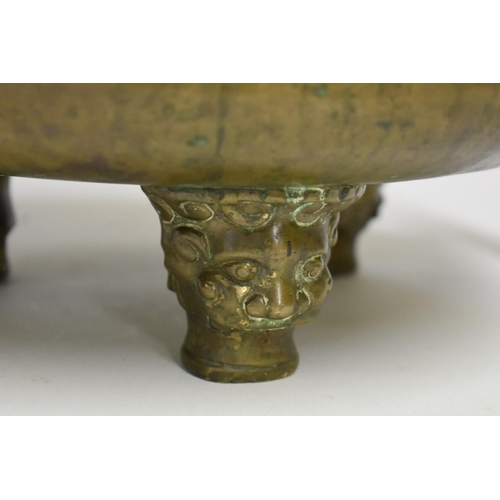 633 - <strong>A very large Chinese twin handled ritual tripod censer,</strong> <em>Qing</em>, with traces ...