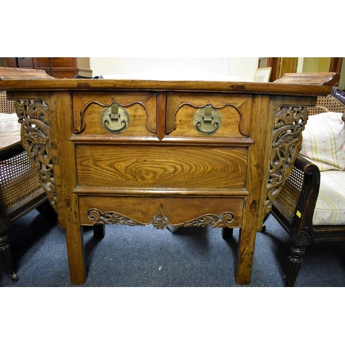 635 - <strong>A Chinese elm alter style side table,</strong> with a pair of frieze drawers, 111cm wide....