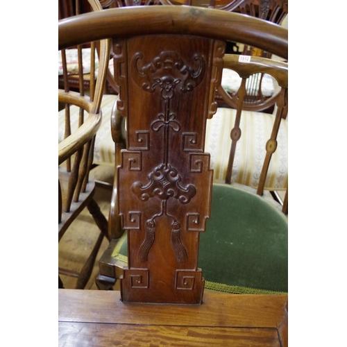 635A - <strong>A Chinese hardwood horseshoe chair <em>quanyi, </em></strong><em>Qing,</em>the back relief ...