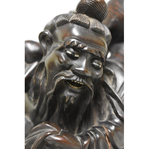 638 - <strong>A Chinese carved hardwood figure,</strong>36cm high....
