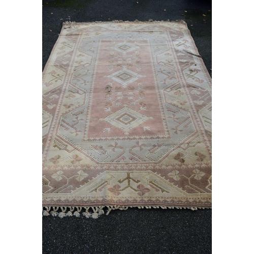 1100 - <strong>A Turkish wool carpet,</strong>having geometric decoration, 367 x 244cm....