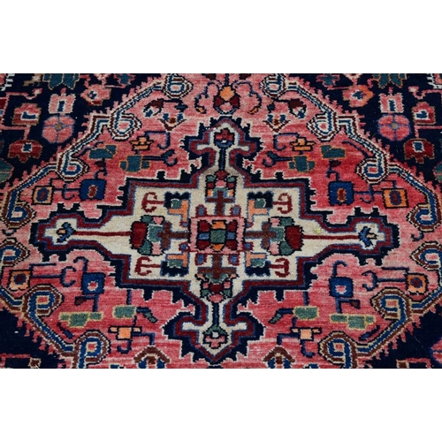 1101 - <strong>An Iranian rug, </strong>having red field with geometric design, 242 x 132cm....
