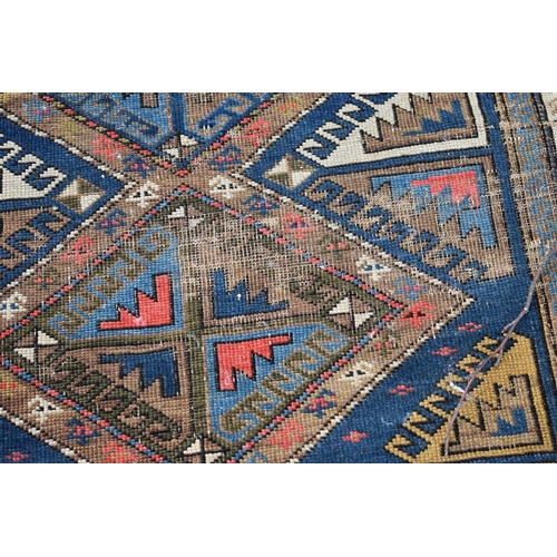 1102 - <strong>A Bokhara rug, </strong>having geometric design, 150 x 113cm....