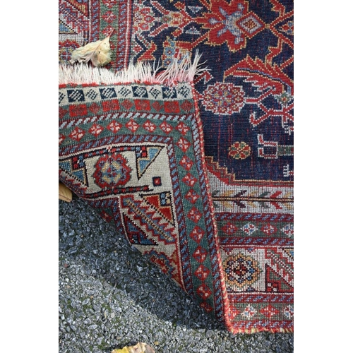 1104 - <strong>An Eastern rug, </strong>with central floral field, having geometric borders, 240 x 115...