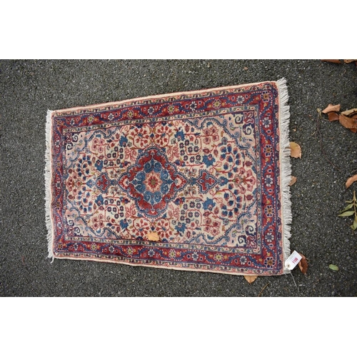 1106 - <strong>A small Persian rug, </strong>with allover floral design, 102 x 70cm....