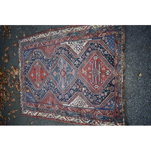 1108 - <strong>An Eastern rug, </strong>having three central medallions, with floral central field and...