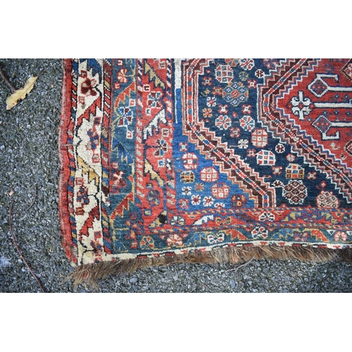1108 - <strong>An Eastern rug,</strong>having three central medallions, with floral central field and...