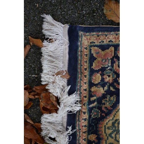 1110 - <strong>A Chinese blue and pink floral rug,</strong>160 x 89cm....