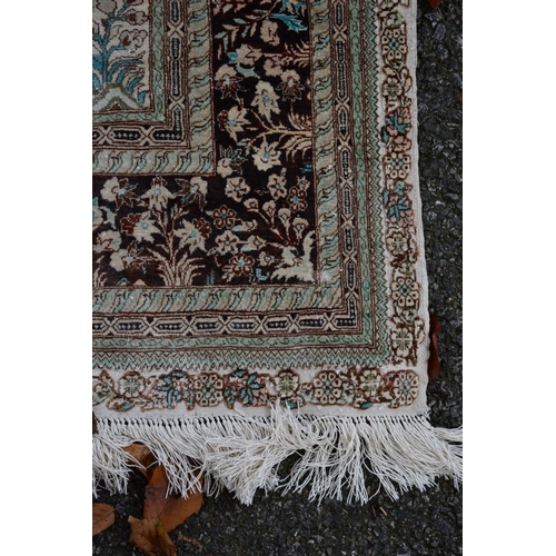 1112 - <strong>An Oriental rug, </strong>having beige field with allover floral design, 195 x 120cm....