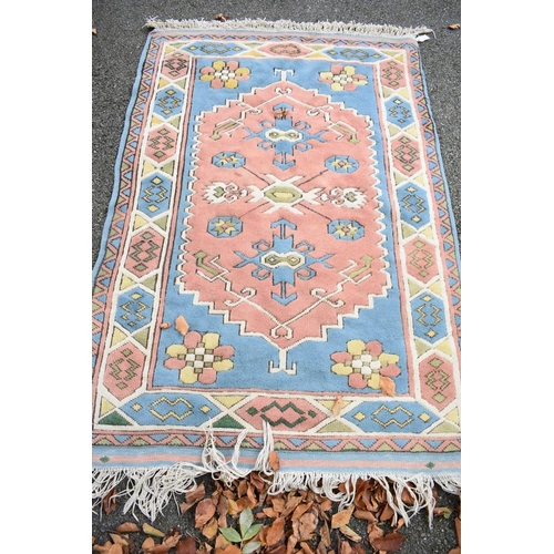1115 - <strong>An Eastern rug,</strong>having geometric design, 200 x 126cm....