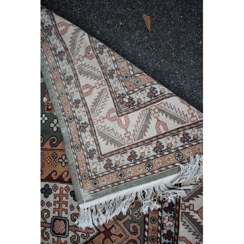 1116 - <strong>An Eastern rug,</strong> having two central medallions on a floral central field, with geome...