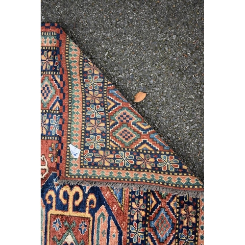 1118 - <strong>A Persian rug,</strong>having three central medallions with floral and geometric borders, 1...
