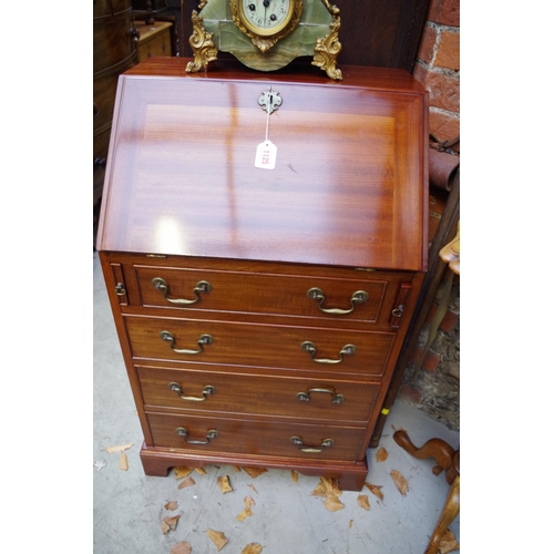 1125 - <strong>A small reproduction mahogany bureau,</strong> 53cm wide. ...