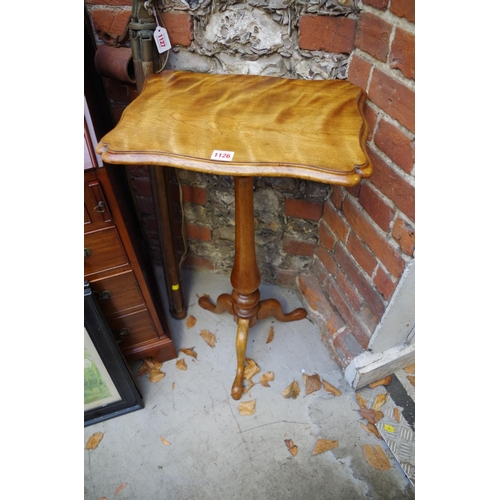 1126 - <strong>An antique birch and maple tripod table,</strong> with shaped top, 43.5cm wide....