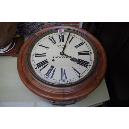 1134 - <strong>A walnut framed wall clock,</strong>the 12in painted dial inscribed 'Smiths, Enfield',...