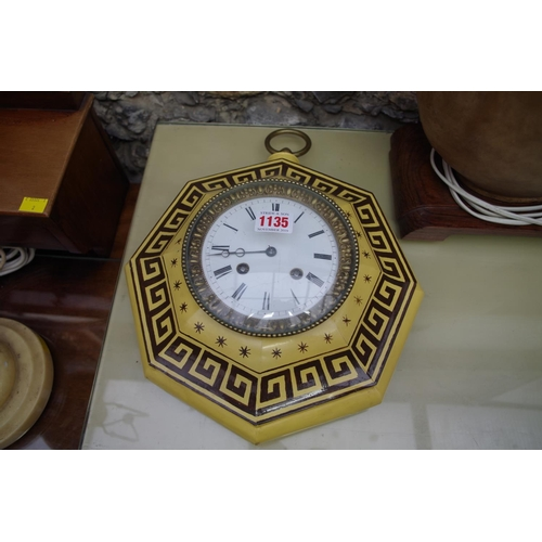 1135 - <strong>An unusual 19th century French toleware octagonal wall clock, </strong>the bell strikin...