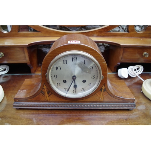 1138 - <strong>A 1930s mahogany and inlaid Westminster chiming Napoleon clock, </strong>43cm wide, with pen...