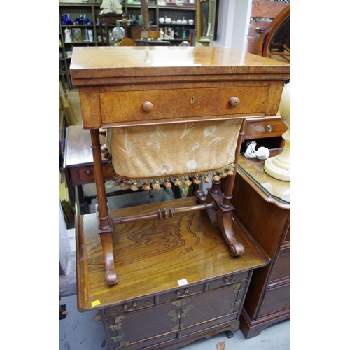 1140 - <strong>A 19th century burr walnut work table,</strong>with foldover swivel action top, 56cm wide....