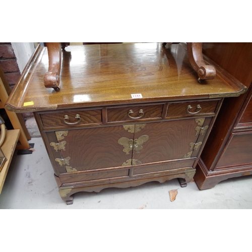 1141 - <strong>A Chinese or Korean elm low side cabinet,</strong>73.5cm wide....