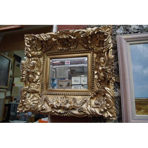 1148 - <strong>A reproduction gilt framed wall mirror,</strong> 47 x 52cm....