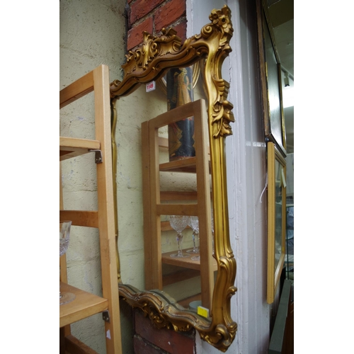 1149 - <strong>A reproduction gilt framed wall mirror,</strong> 76 x 49cm....