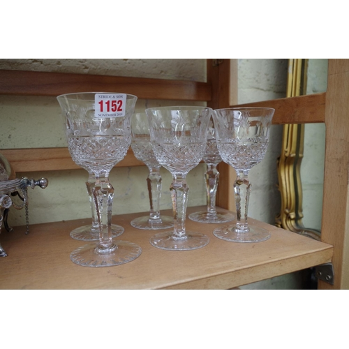 1152 - <strong>A set of six wine glasses,</strong> (variations in height)....