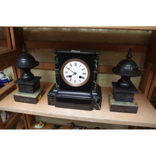 1160 - <strong>A slate and marble mantel clock,</strong>22cm high; together with a pair of slate and ...