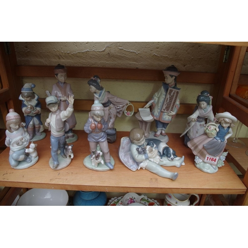 1164 - <strong>Ten Llado figures,</strong>largest 24cm high, each boxed....