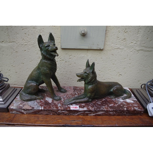 1185 - <strong>A verdigris metal and marble figure group of two alsatians,</strong> 52cm wide. ...