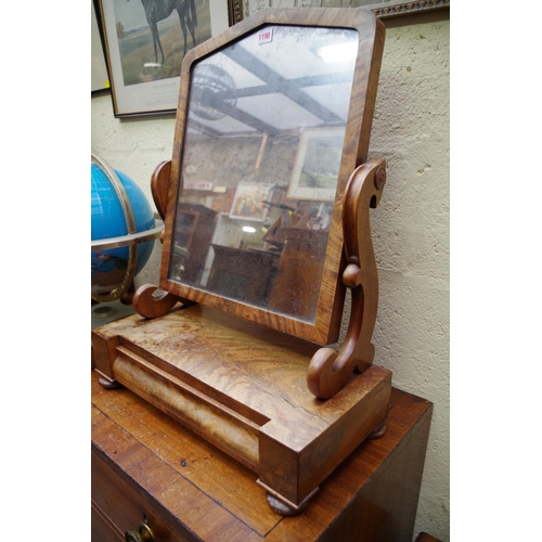 1190 - <strong>A Victorian mahogany toilet mirror,</strong> with apron drawer, 53.5cm wide....