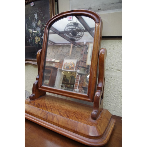 1193 - <strong>A mahogany toilet mirror,</strong> 54cm wide....