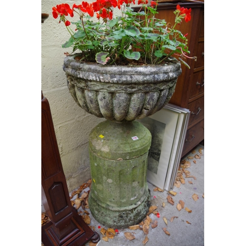 1195 - <strong>An old weathered composition stone urn and pedestal, </strong>55cm diameter x 99cm high....