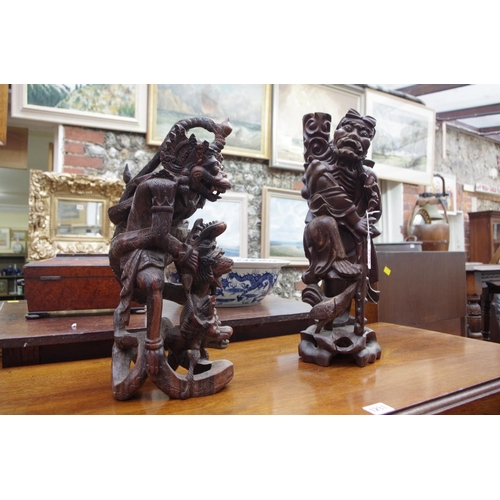 1234 - <strong>Two Eastern carved hardwood figures, </strong>largest 43.5cm high. ...