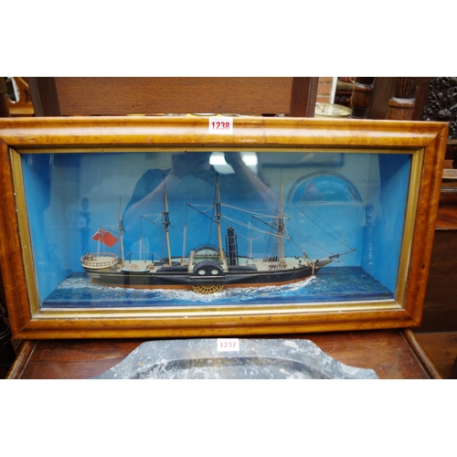 1238 - <strong>A painted diorama of a paddle steamer,</strong> in a bird's eye maple frame, 64cm wide....