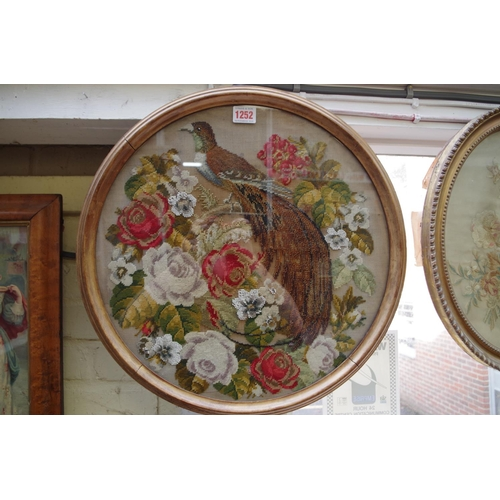 1252 - <strong>A Georgian petit point floral panel, </strong>34.5 x 28.5cm oval; together with a Victorian ...