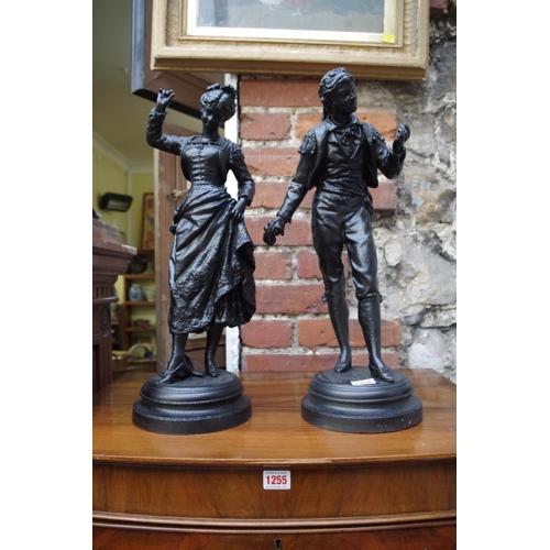 1256 - <strong>After Rancoulet,</strong> a pair of black painted metal figures, 49cm high....
