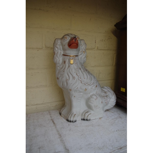 1297 - <strong>A pair of Victorian Staffordshire pottery dogs,</strong> 31cm high....