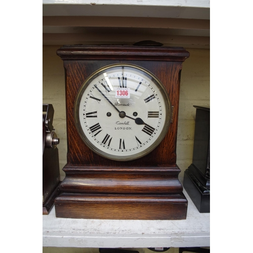 1306 - <strong>An oak mantel clock, </strong>the repainted dial inscribed 'Barrauds, Corn Hill, London', wi...