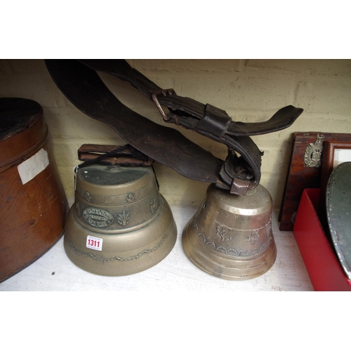1311 - <strong>Two Swiss cow bells,</strong> one inscribed 'Albertan & Sohne, Luzern'....