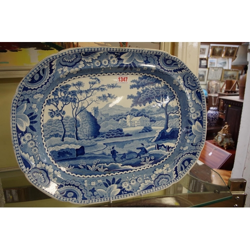 1347 - <strong>A 19th century English pottery blue and white meat plate, </strong>48cm wide....