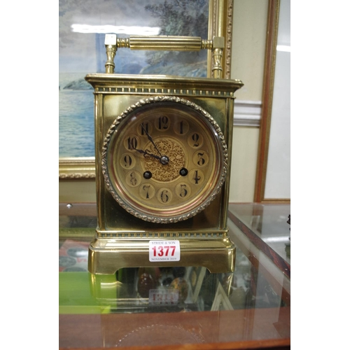 1377 - <strong>A late 19th century brass combined mantel clock and barometer,</strong>25.5cm high....