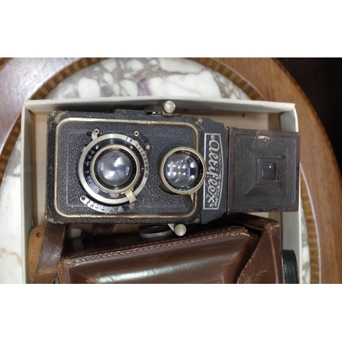 1392 - <strong>Three old cameras,</strong>comprising: a Rolleicord, in leather case; a Ciro-Flex, in leath...