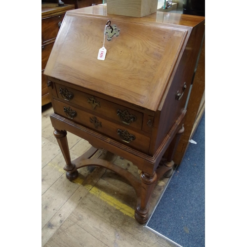 1823 - <strong>A William and Mary style solid yew wood bureau on stand, </strong>56cm wide....