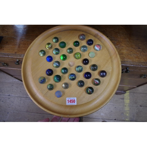 1450 - <strong>A collection of thirty two glass marbles, </strong>on solitaire board....