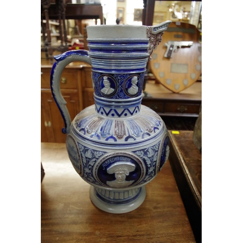 1457 - <strong>A large Mettlach salt glazed jug,</strong> 44cm high....
