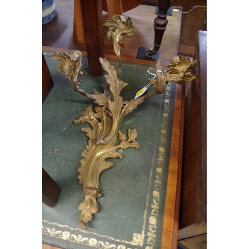 1484 - <strong>A pair of rococo style cast brass three branch wall lights,</strong> 51cm high....
