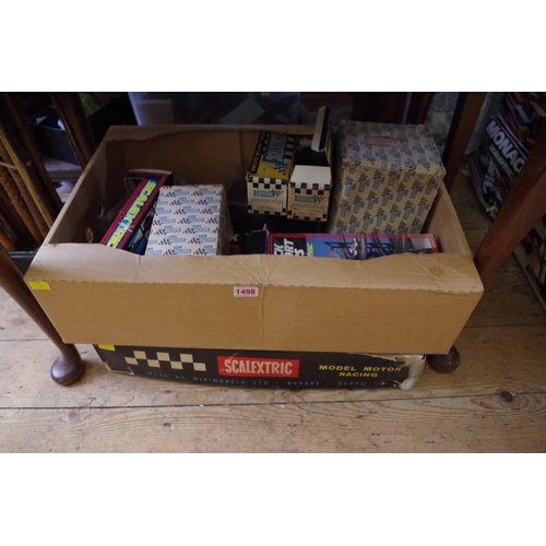 1498 - <strong>A Scalextric</strong><strong>GP33 boxed set; </strong>together with further Scalextric item...