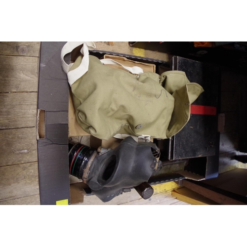 1502 - <strong>A mixed group of World War II items to include,</strong> a gas rattle; a gas mask; first aid...
