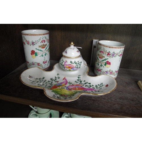 1531 - <strong>A German porcelain desk stand,</strong>25cm wide; together with a graduated pair of Sa...